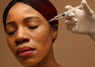 an image of a woman receiving Botox